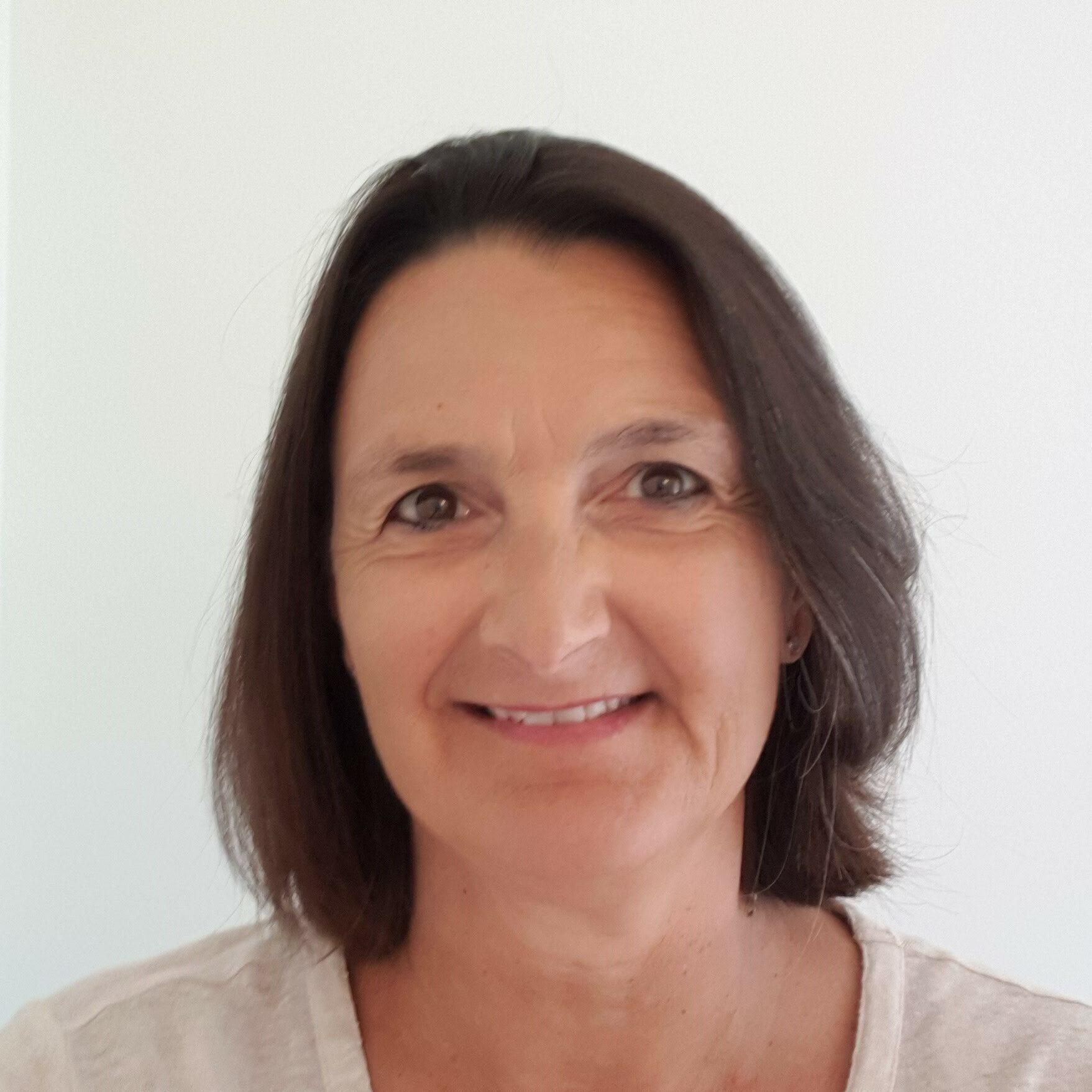 Ms. Christine Cardis